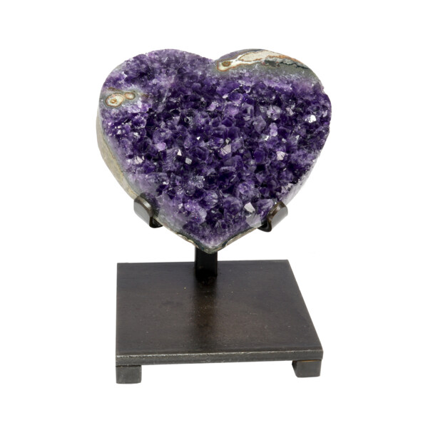 Closeup photo of Amethyst Heart With Stalactite Inclusions On Stand