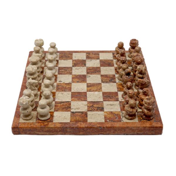 Closeup photo of Onyx Chess Set Red / Beige Travertine