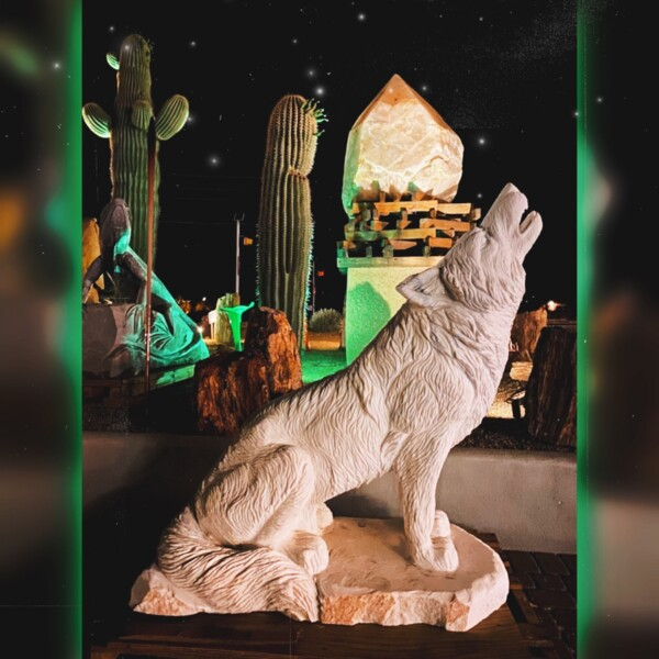 Closeup photo of Crystallized Marble Wolf Carving
