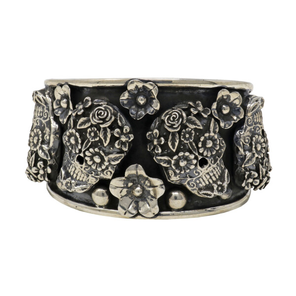 Closeup photo of Sterling Silver Sugar Skull Cuff With 6 Skulls & Flowers