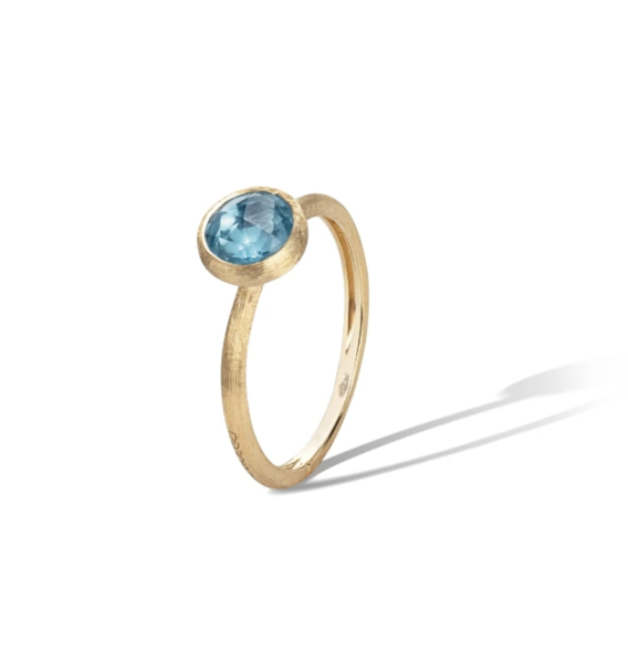 Closeup photo of 18K Yellow Gold & Blue Topaz Stackable Ring