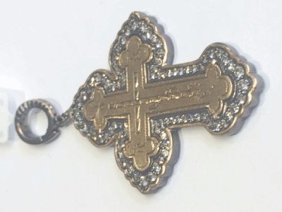 Old Kievan Russian Cross Surriounded by a Yellow Gold and White Aqua Bezel.