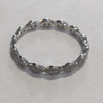 Dark Brown ceramic beads alternating with Sterling Silver beads. The Sterling Silver feature an 18K Rose Gold Vermeil. Beads are on spring steel, making this bracelet stretchable and easy to wear.