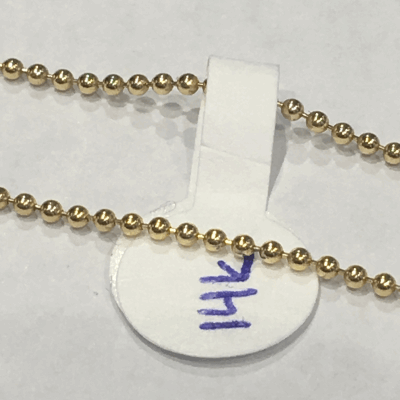 White ceramic beads alternating with Sterling Silver beads. The Sterling Silver feature an 18K Rose Gold Vermeil. Beads are on spring steel, making this bracelet stretchable and easy to wear.