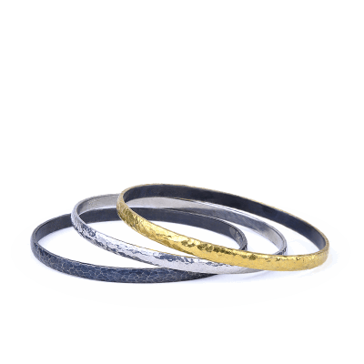 A stunning handpicked 24K Gold, Diamond & Oxidized Hammered Silver & Polished Silver Bangle by designer Kurtulan