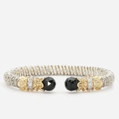 Ladies 14-karat yellow gold and sterling silver 4mm open style fashion bracelet with 0.07 carats of round diamonds and black onyx tips