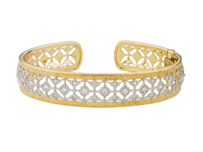 The lacey narrow cuff features 18k yellow gold with prong set round diamonds accented with white rhodium.