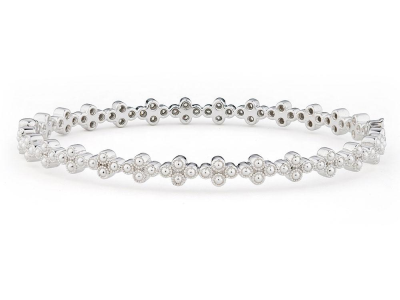 The provence continuous diamond quad bangle features round diamonds bezel set in 18k white gold quads.
