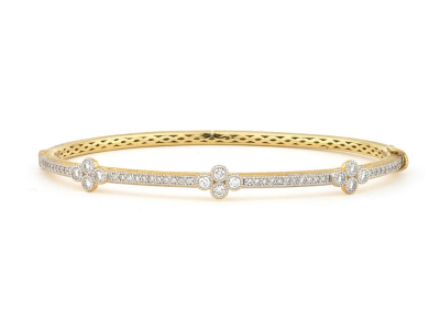 The provence bangle with three diamond quads features 18k yellow gold with pave and bezel set round diamonds.