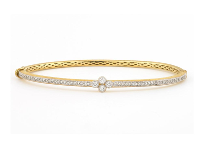 The provence bangle with single diamond quad features 18k yellow gold with pave and bezel set round diamonds.