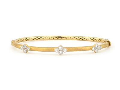 The brushed provence bangle with three diamond quads features round diamonds bezel set in three 18k gold diamond quads on an 18k yellow gold bangle with the signature brushed jfj finish.