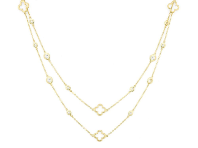 The white sapphire clover chain features round faceted white sapphire stations bezel set in 18k yellow gold with alternating open clover stations on a boston chain. 24 round white sapphires, 2.40 tcw. 32 inches.