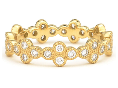 The provence eternity band features bezel set round diamonds set in 18k yellow gold quads.