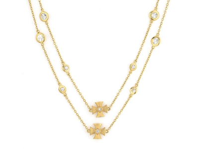 The bezel set stone chain with alternating maltese crosses features round faceted white sapphires set in 18k yellow gold bezels alternating between 18k yellow gold maltese crosses accented with bezel set diamonds. 32 inches.