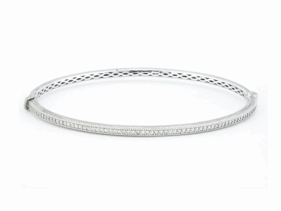 The delicate diamond bangle features round white diamonds pave set in 18k gold with the signature brushed jfj finish.