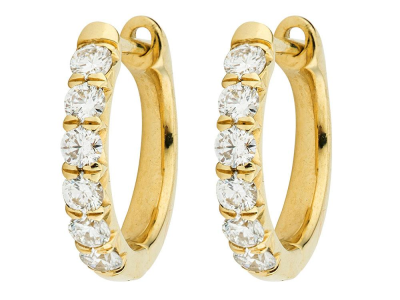 The jude diamond hoop earrings feature sparkling diamonds french pave set in 18k yellow gold.