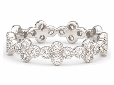 The provence eternity band features bezel set round diamonds set in 18k white gold quads.