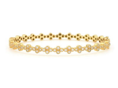 The provence continuous diamond quad bangle features round diamonds bezel set in 18k yellow gold quads.