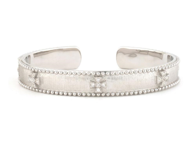 The narrow beaded maltese cuff features round faceted white topaz pave set in sterling silver maltese crosses with white rhodium and the signature brushed jfj finish accented with beaded edges.