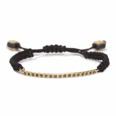 18k yellow gold black diamond bar bracelet on black braided cord. Diamond Weight 0.43ct