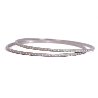Sterling silver vintage finish eternity bangle with white diamonds.  Diamond Weight 0.32 ct.