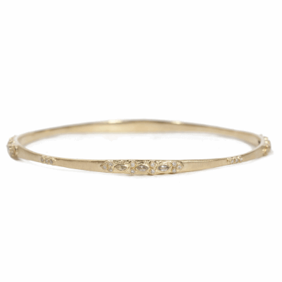 18k yellow gold lacy bangle with white diamonds and white sapphires.  Diamond Weight 0.208 ct.