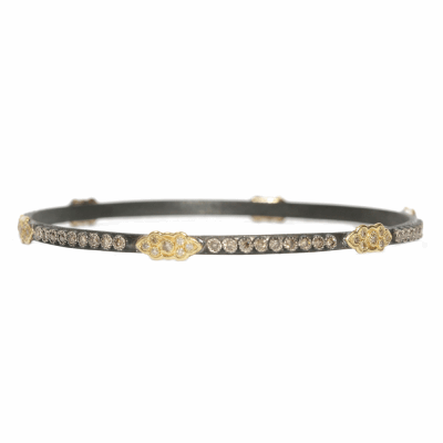 Blackened sterling silver and 18k yellow gold skinny scroll bangle with champagne diamonds.  Diamond Weight 1.644 ct.
