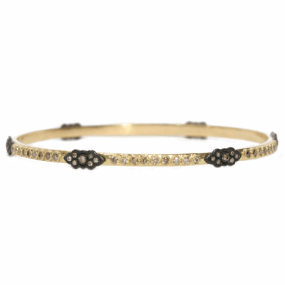 18k yellow gold and blackened sterling silver skinny scroll bangle with champagne diamonds.  Diamond Weight 1.644 ct.