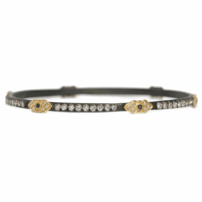 Blackened sterling silver and 18k yellow gold skinny scroll bangle with white and black diamonds.  Diamond Weight 1.266 ct.