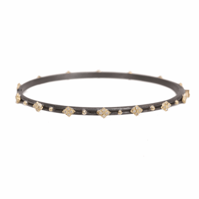 Blackened sterling silver and 18k yellow gold skinny crivelli huggie bracelet with white diamonds.  Diamond Weight 0.224 ct.