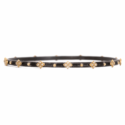 Blackened sterling silver and 18k yellow gold skinny crivelli bangle with white diamonds.  Diamond Weight 0.224 ct.