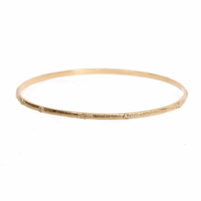 18k yellow gold scattered eternity bangle with white diamonds.  Diamond Weight 0.296 ct.