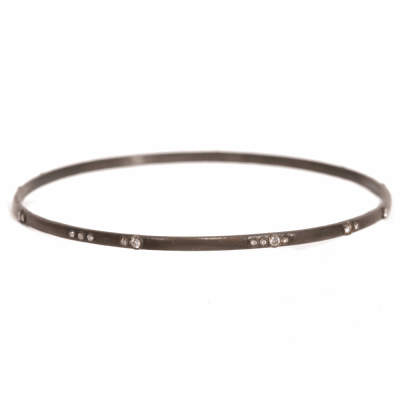 Blackened sterling silver bangle with scattered white diamonds. Diamond Weight 0.276 ct.