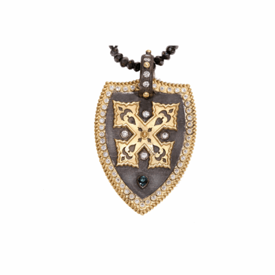 Blackened sterling silver and 18k yellow gold shield enhancer with cross, white diamonds, and green tourmaline. Diamond Weight 0.29 ct.