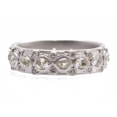 New World sterling silver and blackened sterling silver lacy eternity stack ring with white pear shaped sapphires and white diamonds. Diamond Weight 0.13ct