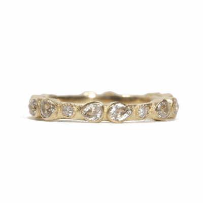 18k Yellow gold scattered stack ring with white diamonds and white sapphires. Diamond Weight  0.12 ct.