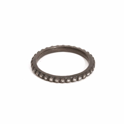 Blackened sterling silver thin stack ring with 1mm white diamonds.  Diamond Weight 0.136 ct.