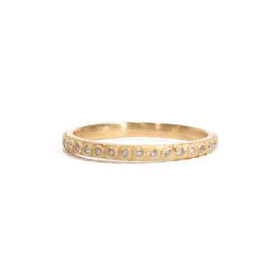18k yellow gold thin stack ring with 1mm white diamonds.  Diamond Weight 0.14 ct.