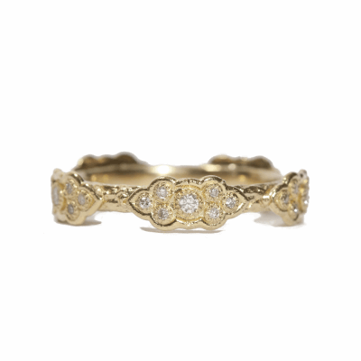 18k yellow gold sculpted scroll stack ring with white diamonds.  Diamond Weight 0.22 ct.