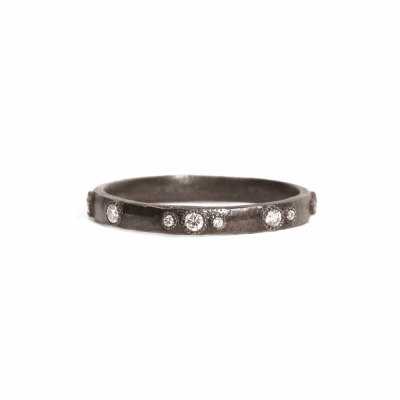 Blackened sterling silver scattered stack ring with white diamonds.  Diamond Weight 0.2 ct.