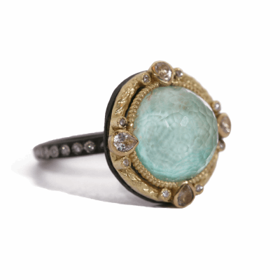 Blackened sterling silver and 18k yellow gold 12mm Green Turquoise round ring with white diamonds and white sapphires. Diamond Weight 0.156 ct.