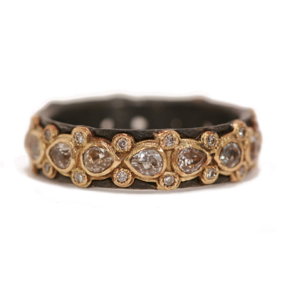 Blackened sterling silver and 18k yellow gold lacy pear eternity stack ring with white diamonds and white sapphires. Diamond Weight 0.128 ct.