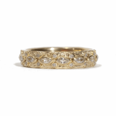 18k yellow gold lacy marquis eternity stack ring with white diamonds and white sapphires. Diamond Weight 0.112 ct.