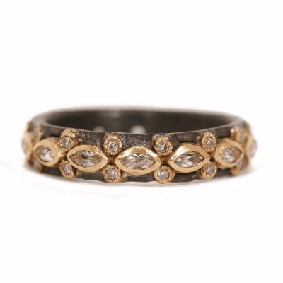 Blackened sterling silver and 18k yellow gold lacy marquis eternity stack ring with white diamonds and white sapphires. Diamond Weight 0.112 ct.