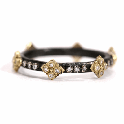 Blackened sterling silver and 18k yellow gold crivelli stack ring with white diamonds.  Diamond Weight 0.168 ct.