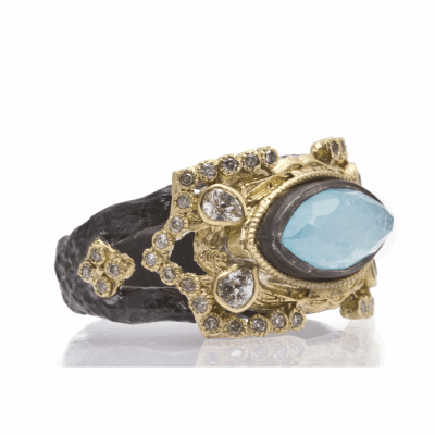 Old World oxidized sterling silver and 18k yellow gold carved marquis ring with Blue Turquoise/Rainbow Moonstone doublet, white diamonds and white sapphires. Diamond Weight 0.17ct