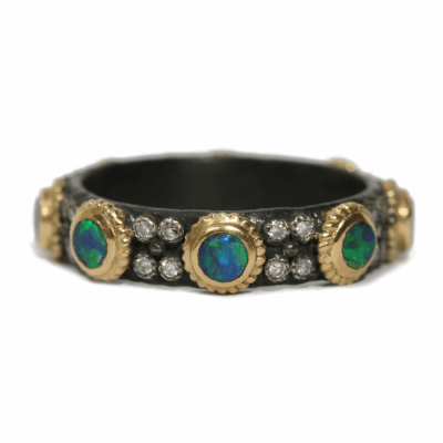Blackened sterling silver and 18k yellow gold 3mm Boulder Opal stack ring with white diamonds.  Diamond Weight 0.128 ct.
