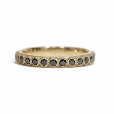 18k yellow gold stack ring with 1.7mm black diamonds.  Diamond Weight 0.675 ct.
