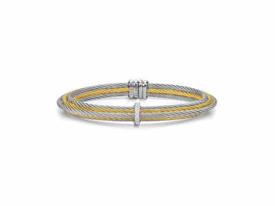 Collection: Sueno Style #: 9635 Description: Sueno 18k yellow gold large artifact saddle disc ring with white diamonds and white sapphires.Metal: 18k Yellow Gold