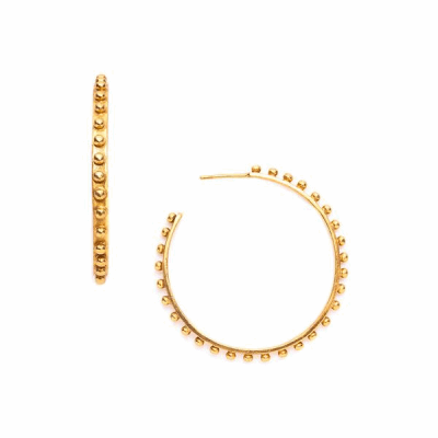 Gold hoop earrings dotted with small gold studs, available in small, medium, and large size hoops.